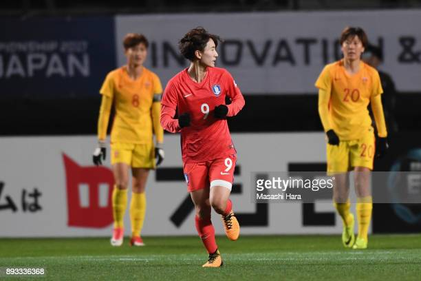 Kang Yumi of South Korea reacts after scoring her side's first goal during the EAFF E1 Women's Football Championship between South Korea and China at...