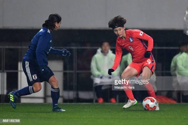 Kang Yumi of South Korea takes on Aya Sameshima of Japan during the EAFF E1 Women's Football Championship between Japan and South Korea at Fukuda...