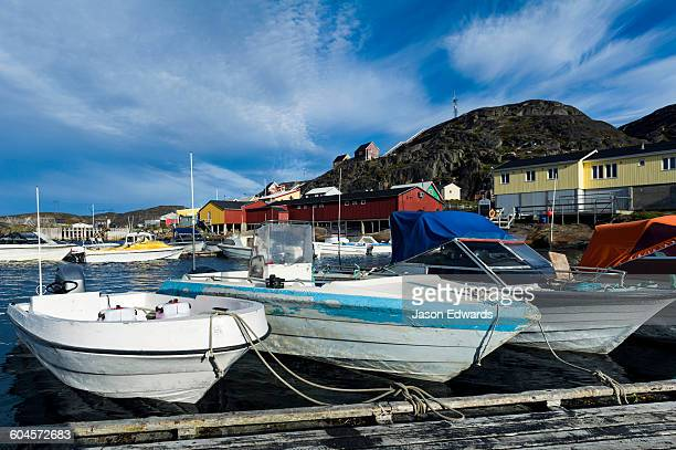 Fishing and recreational boats moored in a fishing town port.