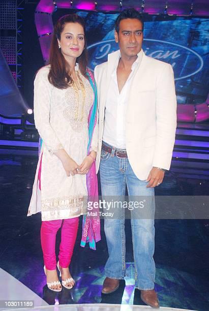 Kangana Ranaut and Ajay Devgan on the sets of Indian Idol 4 in Mumbai on July 20 2010