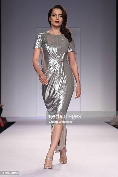 Kangana Ranaut walks the runway wearing designs by Dorothy Perkins at day 3 of Lakme Fashion Week Summer/Resort 2014 at the Grand Hyatt on March 13,...