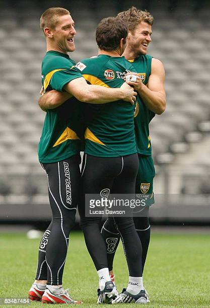 Kangaroo players huddle during an Australian training session held at Telstra Dome October 30 2008 in Melbourne Australia