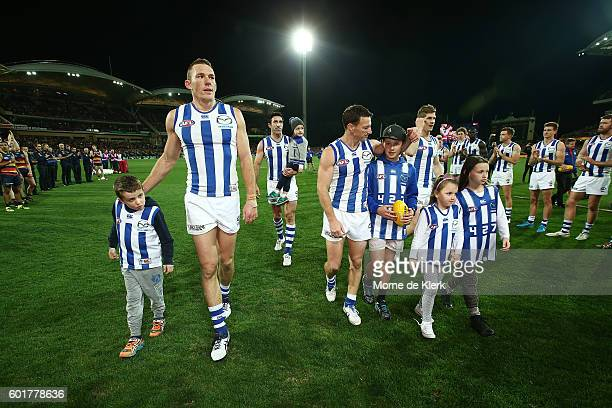 Kangaroo players who will not play for the club next year come from the field after the AFL 1st Elimination Final match between the Adelaide Crows...