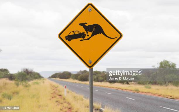 Kangaroo street signs along the side of a highway in Uluru on January 12th 2018 in Alice Springs