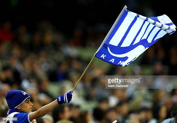 Kangaroo supporter waves his flag during the round seven AFL match between the Collingwood Magpies and the North Melboune Kangaroos at Melbourne...