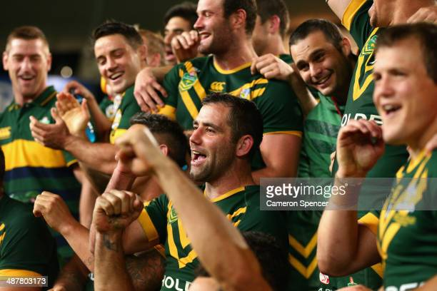 Kangaroos captain Cameron Smith and team mates sing after winning the ANZAC Test match between the Australian Kangaroos and the New Zealand Kiwis at...