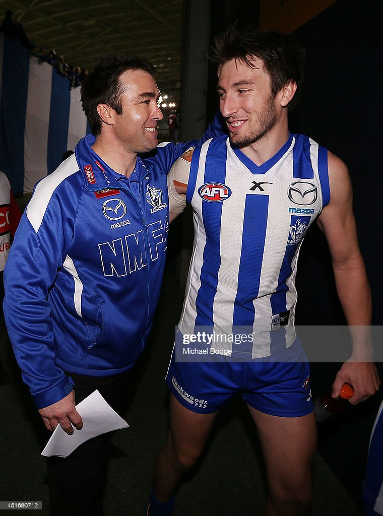 Kangaroos coach Brad Scott and Sam Wright of the Kangaroos celebrate their win during the round 16 AFL match between North Melbourne Kangaroos and the Hawthorn Hawks at Etihad Stadium on July 4, 2014 in Melbourne, Australia.