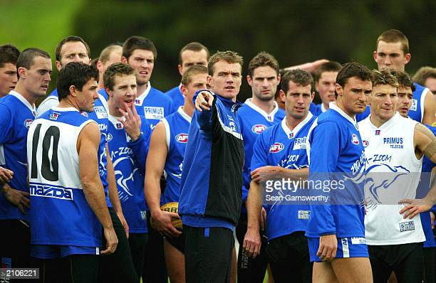 Kangaroos coach Dean Laidley addresses his players during the Kangaroos coaching session at Arden Street Oval on June 23 2003 in Melbourne Australia