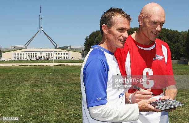 Kangaroos coach Dean Laidley and Peter Garrett Labour member for Kingsford Smith and Midnight Oil lead singer pose after the recreational football...