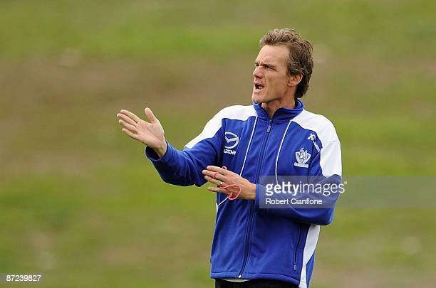 Kangaroos coach Dean Laidley gives instructions to his players during a North Melbourne Kangaroos AFL training session at Arden Street Oval on May 15...
