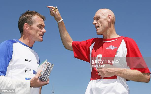 Kangaroos coach Dean Laidley has his Midnight Oil CDs signed by Peter Garrett Labuor member for Kingsford Smith and Midnight Oil lead singer after...