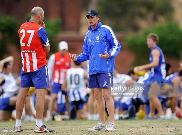 Kangaroos coach Dean Laidley talks to assistant coach Darren Crocker during a Kangaroos AFL training session at Arden Street Oval on February 25 2009...