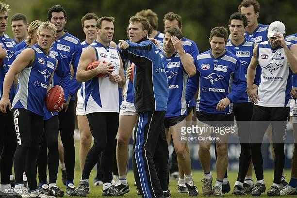 Kangaroos coach Dean Laidley talks to his players during the AFL Kangaroos training Session at Arden Street Oval May 12 2004 in Melbourne Australia