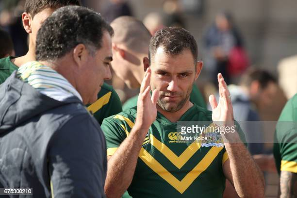 Kangaroos coach Mal Meniga and Kangaroos captain Cameron Smith speak after the team photo during an Australian Kangaroos media opportunity at the...