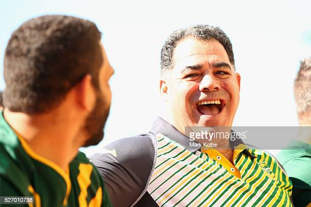 Kangaroos coach Mal Meninga shares a laugh with Greg Inglis during the Australia Kangaroos Test team photo session at Crowne Plaza Coogee on May 2...