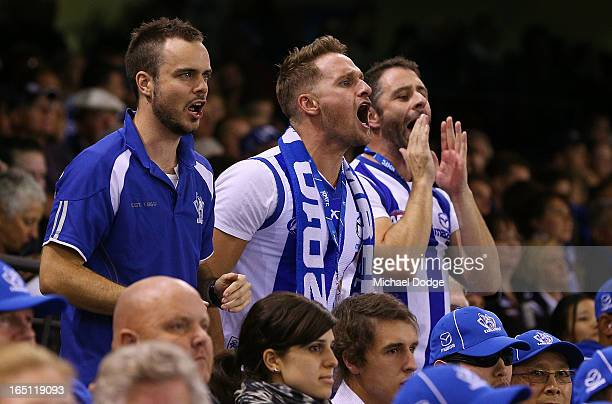 Kangaroos fans show their support during the round one AFL match between the North Melbourne Kangaroos and Collingwood Magpies at Etihad Stadium on...