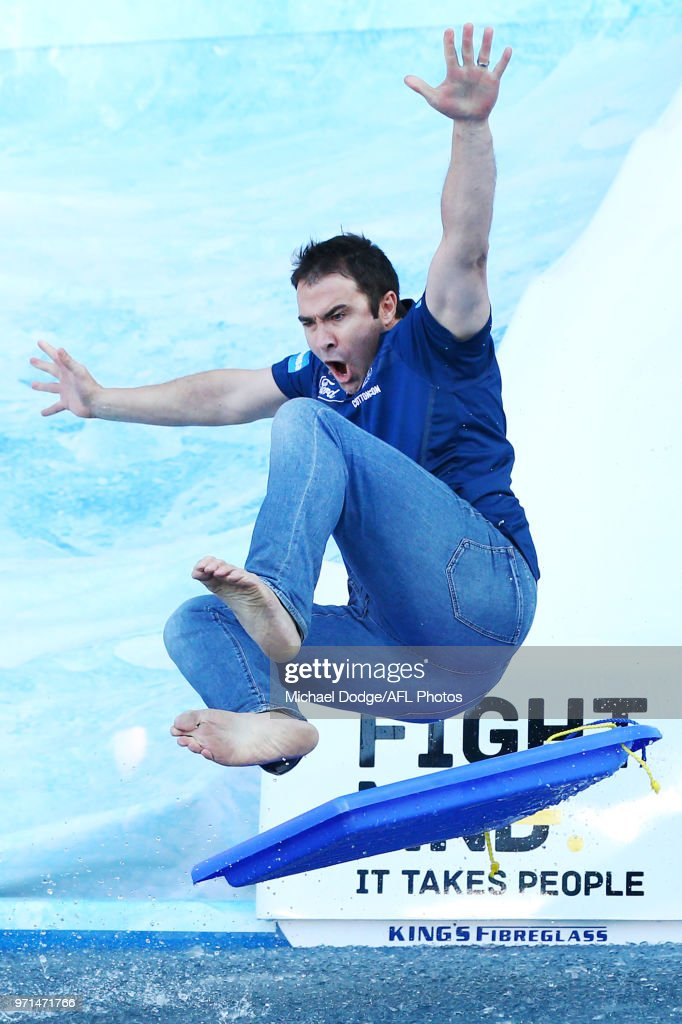 Kangaroos head coach Brad Scott goes down the MND slide during the round seven AFL match between the Western Bulldogs and the Gold Coast Suns at Mars Stadium on May 5, 2018 in Melbourne, Australia.