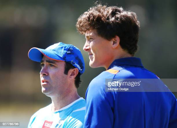 Kangaroos head coach Brad Scott looks upfield with Will Minson during a North Melbourne Kangaroos AFL training session at Arden Street Ground on...
