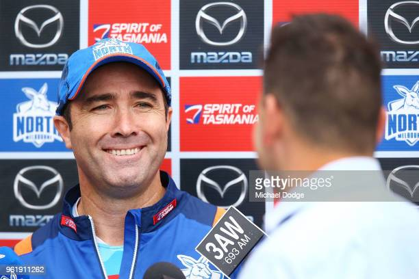 Kangaroos head coach Brad Scott reacts to television reporter during the North Melbourne Kangaroos AFL training session at Arden Street Ground on May...