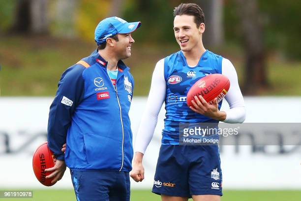 Kangaroos head coach Brad Scott talks to Ben Jacobs of the Kangaroos during the North Melbourne Kangaroos AFL training session at Arden Street Ground...