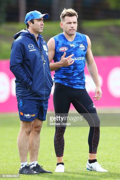 Kangaroos head coach Brad Scott talks with Shaun Higgins of the Kangaroos during a North Melbourne Kangaroos AFL training session at Arden Street on...