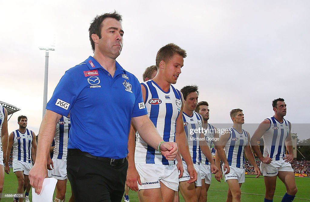 Kangaroos head coach Brad Scott walks off with Andrew Swallow after their defeat during the round one AFL match between the Adelaide Crows and the North Melbourne Kangaroos at Adelaide Oval on April 5, 2015 in Adelaide, Australia.
