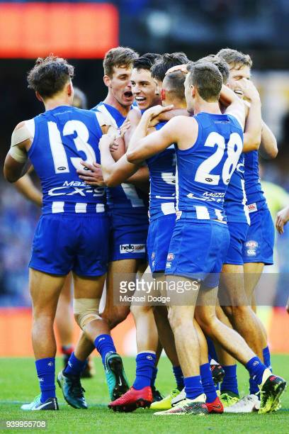 Kangaroos players celebrate a goal during the round two AFL match between the North Melbourne Kangaroos and the St Kilda Saints at Etihad Stadium on...