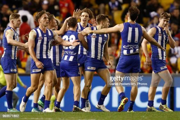 Kangaroos players celebrate a Kayne Turner of the Kangaroos goal duringduring the round 16 AFL match between the North Melbourne Kangaroos and the...