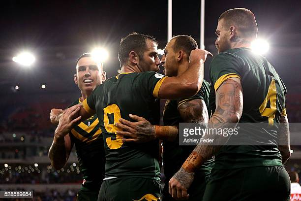 Kangaroos players celebrate a try during the International Rugby League Trans Tasman Test match between the Australian Kangaroos and the New Zealand...