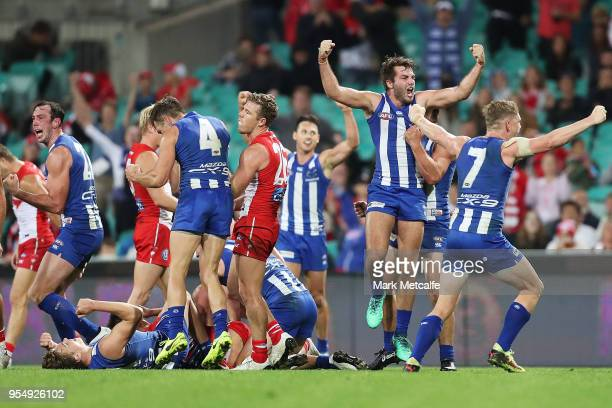 Kangaroos players celebrate victory in the round seven AFL match between the Sydney Swans and the North Melbourne Kangaroos at Sydney Cricket Ground...