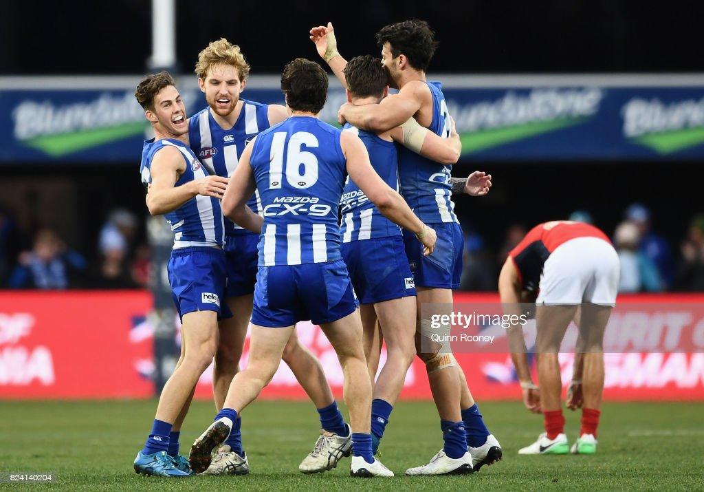 Kangaroos players celebrate winning the round 19 AFL match between the North Melbourne Kangaroos and the Melbourne Demons at Blundstone Arena on July 29, 2017 in Hobart, Australia.