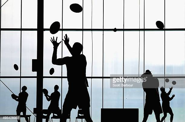 Kangaroos players practise their ball skills inside during a North Melbourne Kangaroos AFL training session at Arden Street Ground on June 3 2014 in...