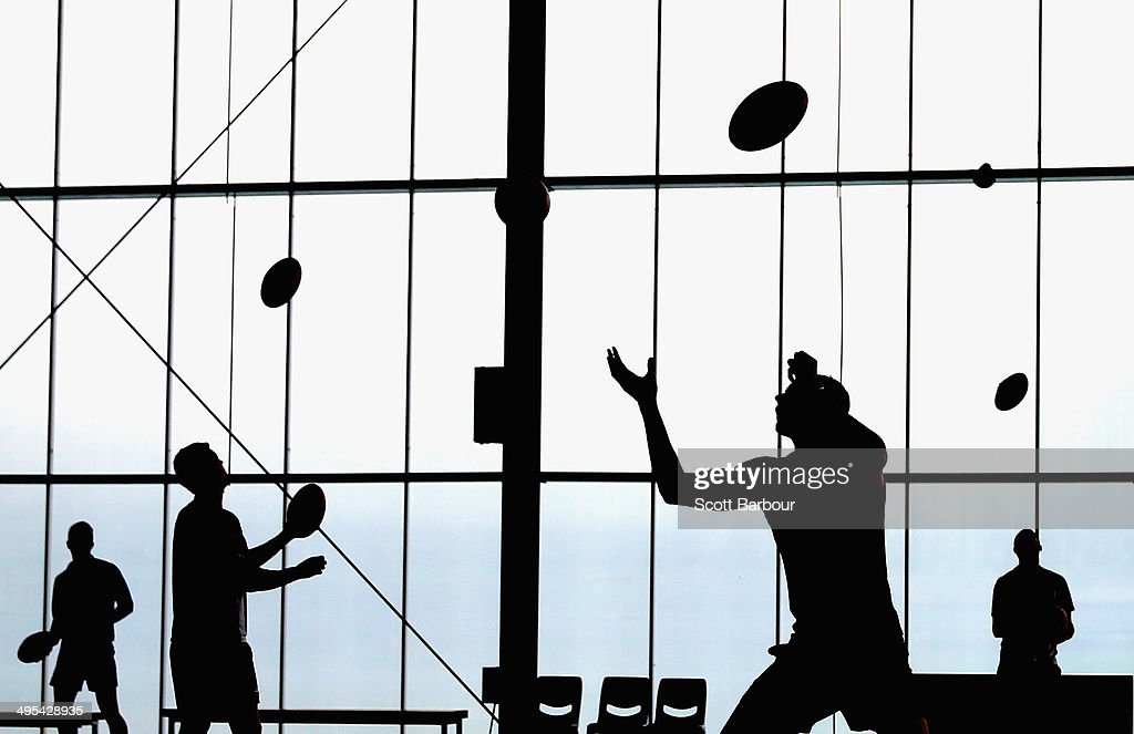 Kangaroos players practise their ball skills inside during a North Melbourne Kangaroos AFL training session at Arden Street Ground on June 3, 2014 in Melbourne, Australia.