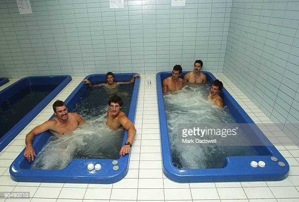 Kangaroos players relax in spa baths in the clubs new training, educational and administration complex at Arden Street on November 30, 2009 in...