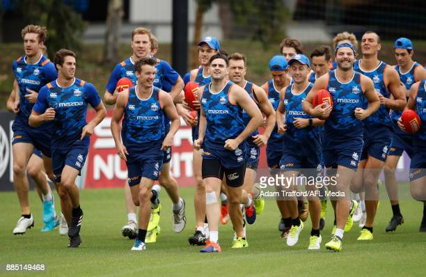 Kangaroos players run laps during the North Melbourne Kangaroos training session at Arden St on December 4 2017 in Melbourne Australia