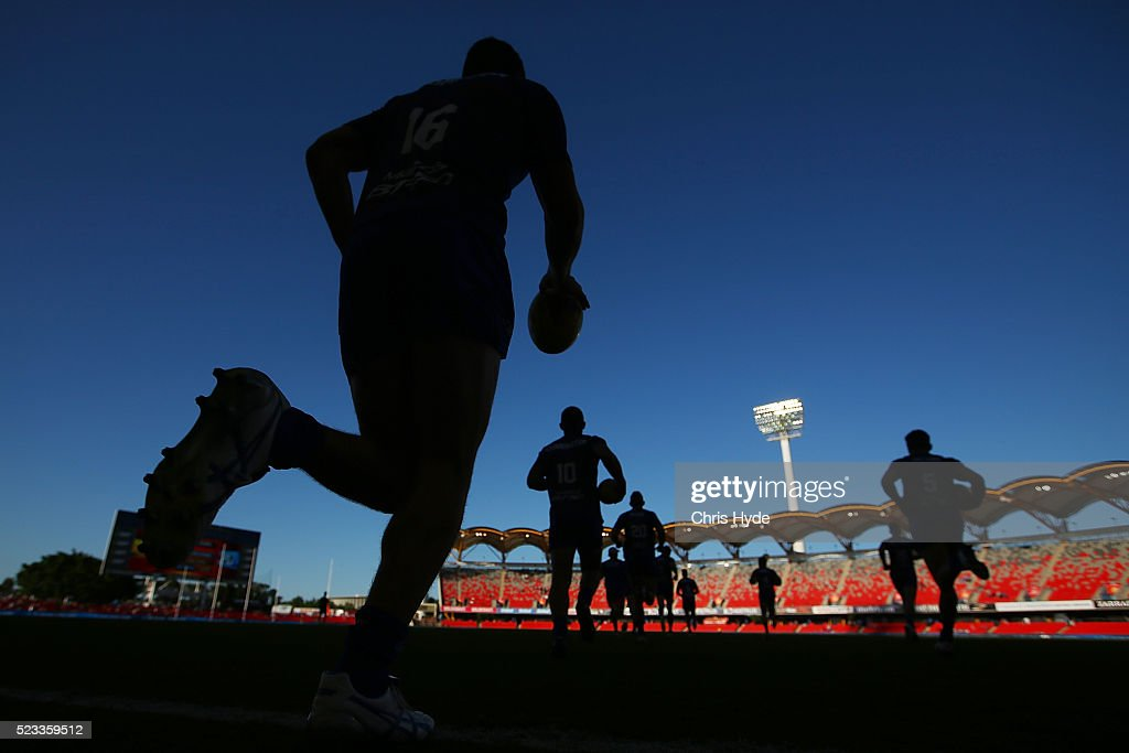 Kangaroos run out before the round five AFL match between the Gold Coast Suns and the North Melbourne Kangaroos at Metricon Stadium on April 23, 2016 in Gold Coast, Australia.