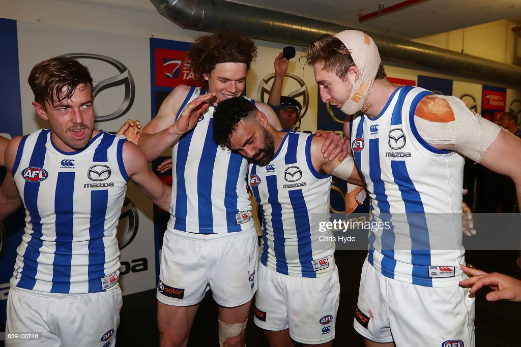 Kangaroos sing the team song after winning the round 23 AFL match between the Brisbane Lions and the North Melbourne Kangaroos at The Gabba on August 26, 2017 in Brisbane, Australia.