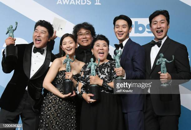 KangHo Song Park Sodam Bong Joonho Lee Jung Eun Lee Sun Gyun and Choi Wooshik pose in the press room after winning the award for Outstanding...