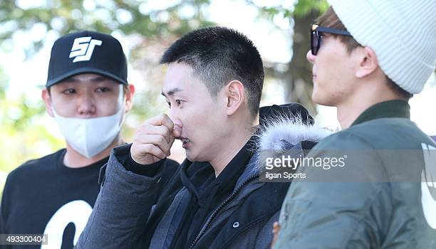 Kangin and Leeteuk of Super Junior see off their memebr Eunhyuk who joins the military service at 102nd division on October 13 2015 in Seoul South...