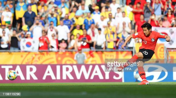 Kangin Lee of Korea Republic scores a penalty for his team's first goal during the 2019 FIFA U-20 World Cup Final between Ukraine and Korea Republic...