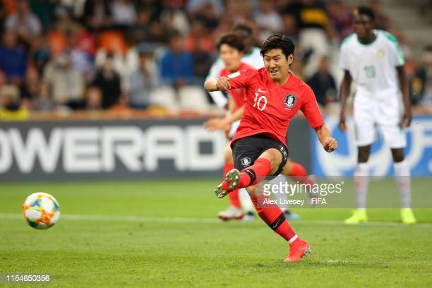 Kangin Lee of Korea Republic scores his team's first goal from the penalty spot during the 2019 FIFA U20 World Cup Quarter Final match between Korea...