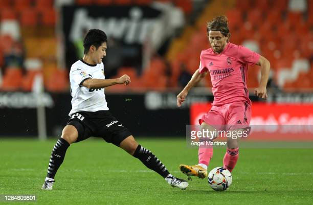 Kang-in Lee of Valencia and Luka Modric of Real Madrid during the La Liga Santander match between Valencia CF and Real Madrid at Estadio Mestalla on...