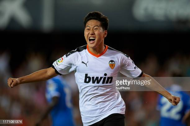 Kangin Lee of Valencia celebrates after scoring his sides first goal during the Liga match between Valencia CF and Getafe CF at Estadio Mestalla on...