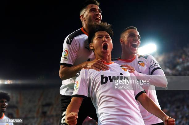 Kangin Lee of Valencia celebrates whit Rodrigo Moreno and Maxi Gomez after scoring his sides first goal during the Liga match between Valencia CF and...