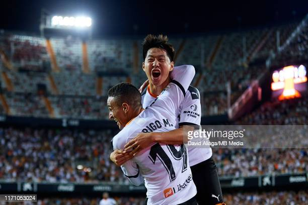 Kangin Lee of Valencia CF celebrates his side's third goal with his teammate Rodrigo Moreno during the Liga match between Valencia and Getafe at...
