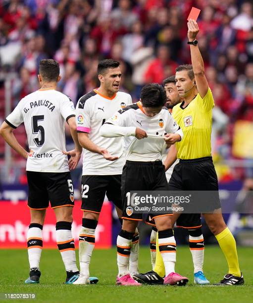 Kang-in Lee of Valencia CF is shown the red card during the Liga match between Club Atletico de Madrid and Valencia CF at Wanda Metropolitano on...