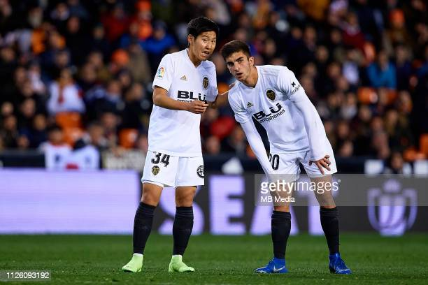 Kangin Lee of Valencia CF talks with his teammate Ferran Torres during the Copa del Rey Quarter Final match between Valencia CF and Getafe CF at...