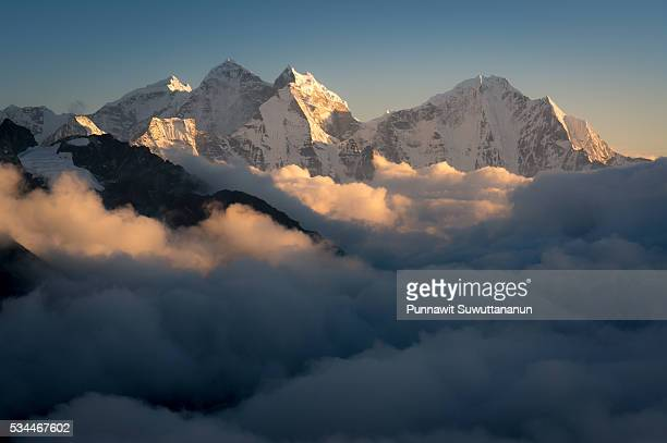 Kangtega and Thamserku mountain peak above the cloud, Everest region