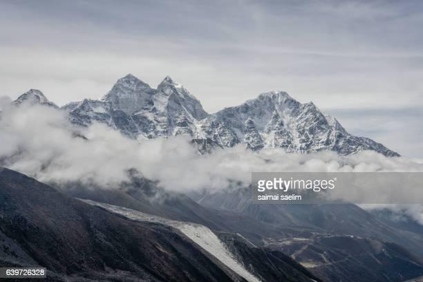 Kangtega and Thamserku mountain peak in the cloud