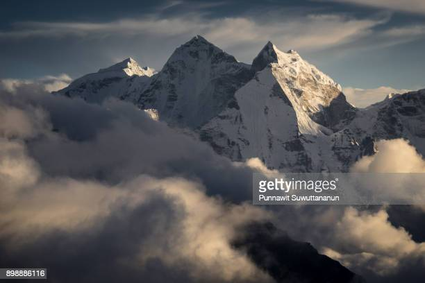 Kangtega mountain peak above the clouds from Kalapattar view point, Everest region, Nepal